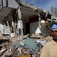 Padang, Western Sumatra, Indonesia, 7th October 2009:?A man stands outside hios bosses collapsed building on Jalam Pondok in Padang following a devastating earthquake in Western Sumatra that claimed the lives of an estimated 2000 people.?Photo: Joseph Feil