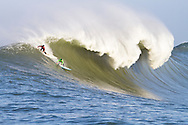 """Evan Slater (left) and Grant """"Twiggy"""" Baker surf a giant wave during the first heat of the Mavericks surf contest Saturday, Feb. 13, 2010, in Half Moon Bay, California"""