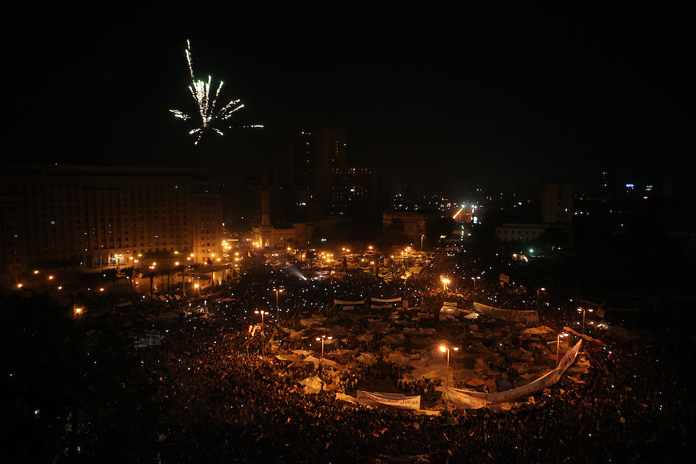 Fireworks over pro-democracy protesters at Tahrir Square celebrating minutes after Vice President Omar Suleiman announced live on TV that Hosni Mubarak had resigned as president of Egypt.