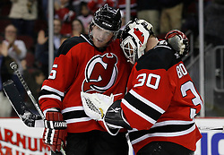 Feb 26, 2009; Newark, NJ, USA; New Jersey Devils defenseman Colin White (5) congratulates New Jersey Devils goalie Martin Brodeur (30) at the Prudential Center. The Devils defeated the Avalanche 4-0.
