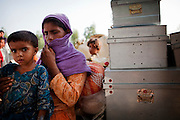 A mother and her daughter arrive with their belongings  at a makeshift camp for persons displaced by the extensive flooding in Gujrat Town, district of Muzzafargarh,  South Punjab....Those fleeing the flooding reported an estimated 200 houses washed away or destroyed by flooding. Most inhabitants of Gujrat earn a living through agriculture, farming Rice, Sugar and Cotton. No deaths were reported by the villagers however they estimate that 90% of the herd of cattle and goats have been lost to flooding. ..Within the makeshift camp children are suffering with diarrhoea and skin complaints. There is no shelter, no sanitation, no access to clean water and no electricity. Most of the IDP's sleep under the trees for shelter from the rain. They complain that they have received very little food and water, and only one one occasion had any access of medical supplies via a private donor...