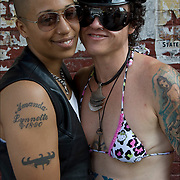Lesbian couple with tattoos at S&M Street Fair