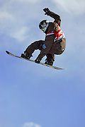 Shaun White of Carlsbad, Ca. blasts out of the halfpipe during a qualifying run for the finals at the Chevrolet U.S. Snowboard Grand Prix in Breckenridge, Co. on Wednesday December 14, 2005. The U.S. Snowboard Grand Prix event is the first of three stops in a series that will determine who will make the U.S. Snowboard Team that will head over to the 2006 Winter Olympics in Torino, Italy. Twelve women and 25 men competed in the Superpipe at Breckenridge in the first of two finals Wednesday. The event continues through Saturday. White won both finals at the event qualifying for a spot on the U.S. Snowboard Team with the wins..(Photo by Marc Piscotty / © 2006)