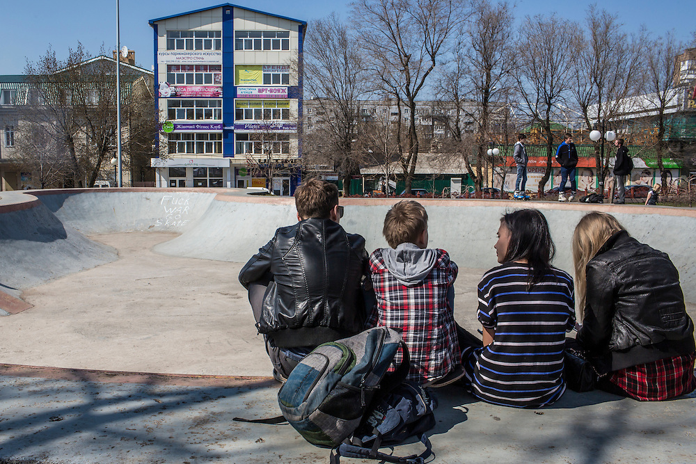 Teenageers sit in a skate park on Sunday, April 12, 2015 in Donetsk, Ukraine.