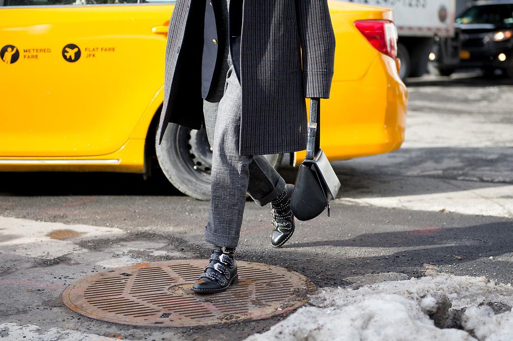 Man with Givenchy Purse, Outside Carolina Herrera FW2017