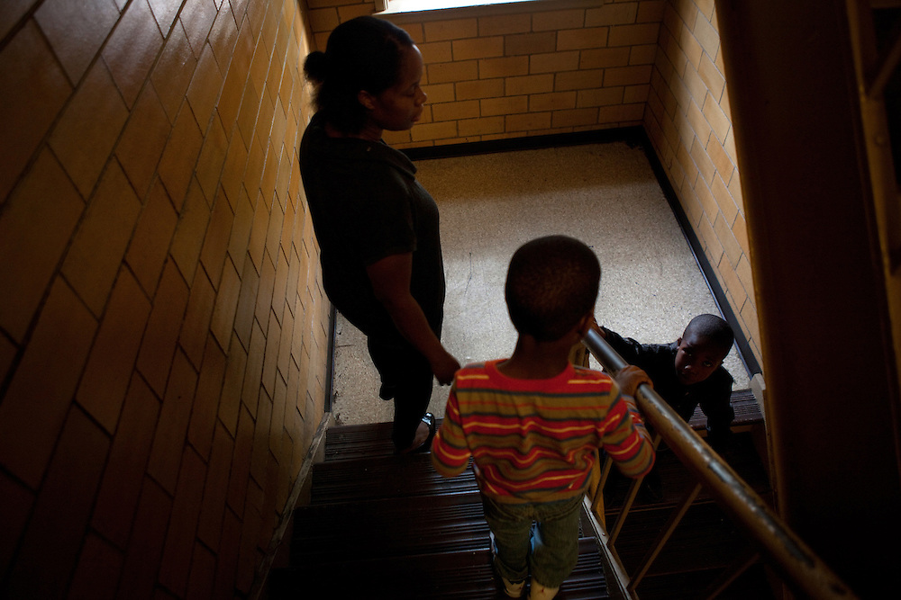 Cherie Michaux, with her son Ja'kye Brown, 7, and her nephew Quaheem Moreau, 3, leaving their apartment to play outside in Port Chester, NY on October 27, 2012. Cherie Michaux could have benefitted if Westchester County had integrated its housing as it had been ordered to do so.