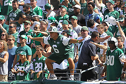 Sept 9, 2012; East Rutherford, NJ, USA; Fireman Ed cheers during the first half of the game between the New York Jets and the Buffalo Bills at MetLIfe Stadium.