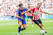 EINDHOVEN - PSV - Feyenoord , Voetbal , Seizoen 2015/2016 , Eredivisie , Philips Stadion , 30-08-2015 , PSV speler Luuk de Jong (r) in duel met Speler van Feyenoord Eric Botteghin (l)