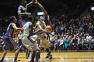 "Mississippi's Marshall Henderson (22) shoots between LSU's Johnny O'Bryant III (2) and LSU's Jarell Martin (12) at the C.M. ""Tad"" Smith Coliseum in Oxford, Miss. on Wednesday, January 15, 2013. (AP Photo/Oxford Eagle, Bruce Newman)"