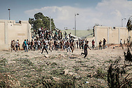 Libyan rebels attack Bab Al Azizyia,  Gadhafi headquarters compound in Tripoli. After a Caterpillar opened a breach in the outer wall and rammed the main gate, the rebels swarm the compound.<br />