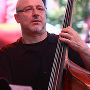Jazz double bassist Ben Wolfe performs with Jazz Artist Dianne Schuur in front of a large crowd at the 26th annual duPont Clifford Brown Jazz Festival Wednesday, June 18, 2014, at Rodney Square Park in Wilmington, DEL.    <br /> <br /> &ldquo;The Clifford Brown Jazz Festival is a staple of Wilmington&rsquo;s performing arts culture,&rdquo; said Mayor Dennis P. Williams. &ldquo;The City is excited to celebrate the 26th anniversary and I hope the community gets involved and enjoys all of the many activities the festival has to offer.&rdquo;