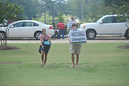 Melissa Dent (left) gets help from her brother Addison Dent as she moves into a dorm at the University of Mississippi in Oxford, Miss. on Wednesday, August 17, 2011. Classes for the fall semester begin Monday, August 22, 2011.