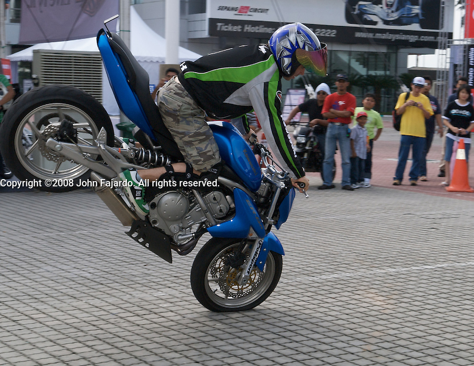 Motorcycle stunt rider at the Polini Malaysian Motorcycle Grand Prix at the Sepang Circuit, Selangor Malaysia, October 17, 2008.