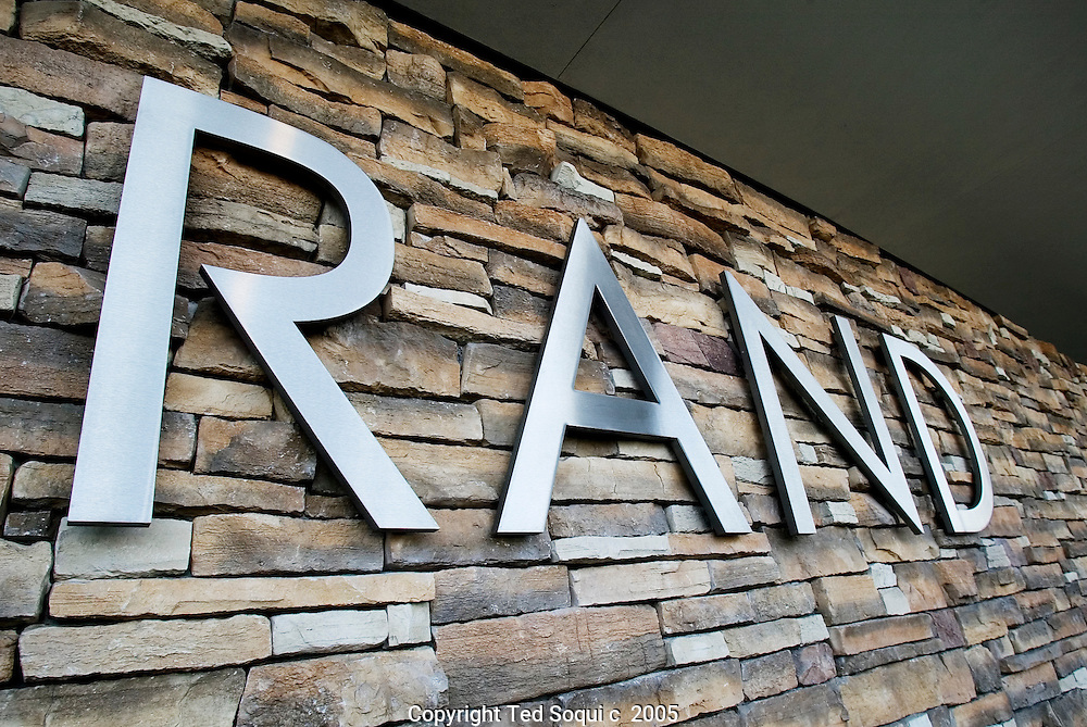 Flagstone accents at the new headquarters for RAND Corporation. . The 300,000 square foot office building, built in a shape of an elipse, helps to maximize synergy between building and the environment.