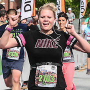 Kristin Maiden (2703) of Middletown, DE., celebrates finishing the 13th Annual Discover Bank Delaware Marathon Sunday, May 8, 2016, at Tubman Garrett Riverfront Park, in Wilmington Delaware.