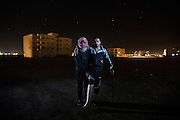 Nayf, 22, from Homs City, Syria, pictured with an unnamed comrade from the Free Syrian Army, in Al Mafraq, northern Jordan. <br /> <br /> &quot;It was a Friday and every Friday we had a protest. We [volunteers of the Free Syrian Army] would protect the protestors from the [Syrian] army, there were 15 of us and we had Kalashnikovs. When the protestors were moving from one area to another we heard that a Syrian army bus was on the way, eventually the bus came and stopped beside the protestors and opened fire, 14 were shot and we started to defend the people. While I was shooting at the army another bus load came and shot me. I was hit by 2 bullets in the leg. I fell down and the colleague who tried to help me was also shot, there were many injured on the ground. We were far from our colleagues but one threw a rope to me and pulled us from the place. <br /> <br /> In Syria it is better to die than be injured, there is no help there. In the hospital the doctors put children in the garbage bins to hide them from the Syrian army when they came to look for injured people. I was assisted by the FSA to get to Jordan, it was very difficult, we were 60 persons with women and children and 7 injured. We had to walk the last 2 km until the Jordanian army received us, I was carried by different people. After 4 days I went to the hospital in Irbid and the doctor removed the bullet and fixed the bone. <br /> <br /> Once my leg is better I will return to Syria. There is not enough provisions for all the refugees here now. I die 1000 times when I hear the news from Syria. I have no future if the regime stays, it is the same for all of us. There is no consensus for what to do in Syria, the UN observers seem to be supporting Bashar, they gave him 3 months for a ceasefire but he has used this time to kill more people. You just hear the numbers of killed but you don't' see them, that is a horrible thing that we deal with alone&quot;.