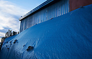 Tarps behind The Trading Post, Taos county