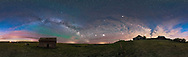 How many sources of skyglow can you pick out here?<br /> <br /> &bull;&nbsp;The Milky Way<br /> &bull; Airglow<br /> &bull; Light pollution (too much!)<br /> &bull;&nbsp;Perpetual northern twilight<br /> &bull;&nbsp;Aurora<br /> <br /> The Milky Way (at left) arches over an old pioneer farmstead from the 1930s and 40s near home in southern Alberta. Mars (very bright and in some clouds) and Saturn shine at lower centre, while Jupiter is the bright object in clouds at right just above the old house. Arcturus is the brightest star here at upper right of centre, made more obvious here by shining through the clouds. The Big Dipper, distorted by the map projection used in the this panorama, is at upper right.<br /> <br /> Light pollution from Strathmore and Calgary lights the clouds coming in from the west. Green airglow is visible below the Milky Way. Twilight provides the blue to the northern sky at either end. There&rsquo;s a very slight aurora low in the north but hardly noticeable. <br /> <br /> This is a 360&deg;&nbsp;horizon to zenith panorama taken with the iPano motorized panning unit, using the 24mm lens at f/2.8 and Nikon D750 at ISO 6400, for a stitch of 28 panels, in 4 tiers of 7 segments each. Stitched with PTGui. <br /> <br /> South is at centre, north to either end. The original is 25,700 x 7,700 pixels.