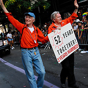 "Gay couple with sign ""52 Years Together"" 3 years married! at the Gay Pride Parade in New York City"
