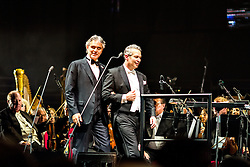 ANAHEIM, CA - JUN 9: Italian tenor Andre Bocelli performed Granada, New York, La Boheme, LaTraviata among others keeping audience mesmerized at the Honda Center in Anaheim, CA. The magical night included producer David Foster on Piano, Violinist Caroline Campbell, American Idol Season 3 winner Soul Singer Fantasia, Cuban Soprano Maria Aleida and Orchestra Conductor Eugene Kohn. Condutor Eugene Kohn (R) and Italian Soprano Andrea Bocelli (L) enter the stage. All fees must be agreed prior to publication, Byline and/or web usage link must  read  PHOTO: SilvexPhoto.com