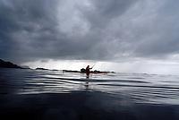 Kayaker in rainy weather outside Florø - Sogn og Fjordane - kajakkpadler i regnvær