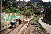 The tren macho makes its entrance to the city of Huancavelica.
