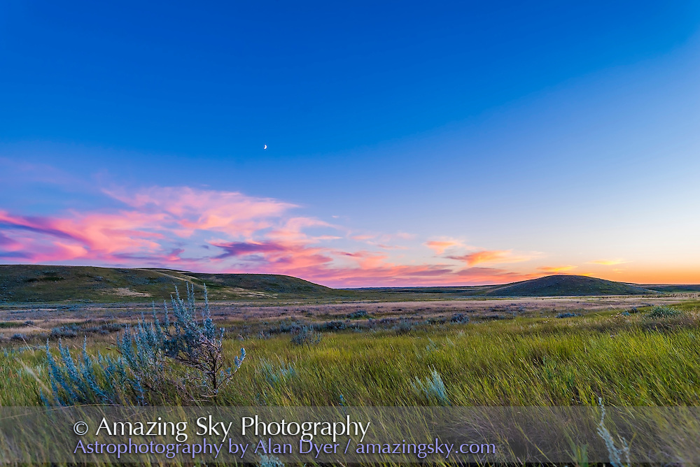The waxing crescent Moon in twilight over the sage and priairie grass of Grasslands National Park, Saskatchewan, in the Frenchman River valley, August 8, 2016. This is one frame from a 300-frame time-lapse.