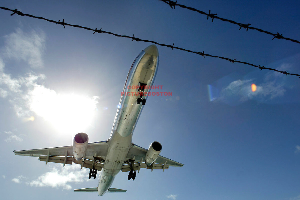 """Various airliners flying in and around St Maarten.   Very long lens. NO trickery or photoshop. All photos are """"real time"""" with no trickery or multiple exposure."""