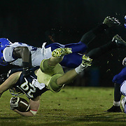 Salesianum Running Back Colby Reeder (28) dives for extra yards as Middletown Defensive Back Kedrick Whitehead (3) defends in the third quarter Friday, Oct. 09, 2015 at Bernard Stadium in Wilmington, DE.