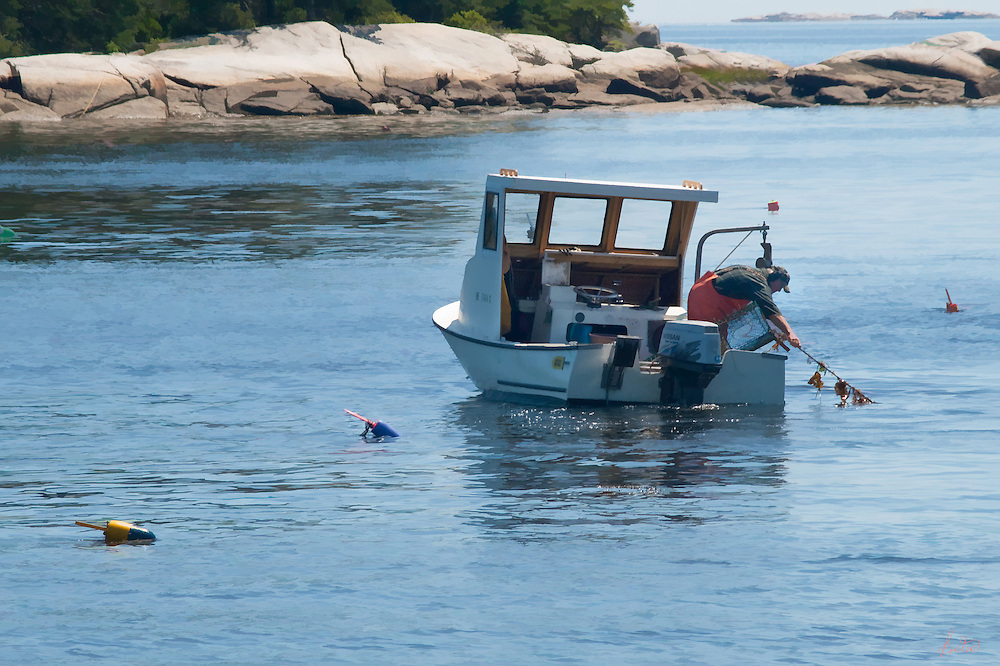 Lobster man hauling in the traps in Penobscot Bay in Maine. Great slice of Maine life.