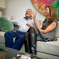 UK. London. Billionaire Hotel owner Sol Kerzner and his wife Heather in their luxury home in Holland Park, West London. Behind them is a Damien Hirst painting..