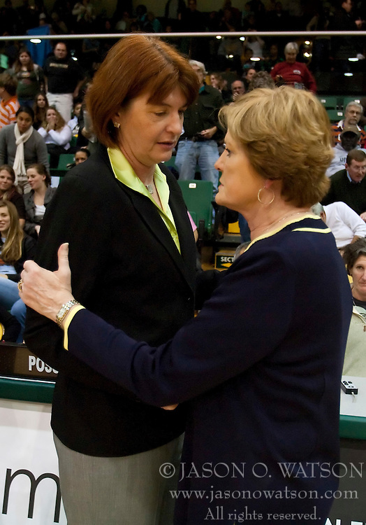 December 22, 2009; San Francisco, CA, USA;  San Francisco Dons head coach Tanya Haave and Tennessee Lady Volunteers head coach Pat Summitt meet after the game at War Memorial Gym.  Tennessee defeated San Francisco 89-34.