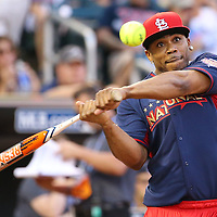 MINNEAPOLIS, MN - JULY 13:  Nelly takes a swing at the 2014 MLB All-Star legends and celebrity softball game on July 13, 2014 at the Target Field in Minneapolis, Minnesota.(Photo by Adam Bettcher/Getty Images) *** Local Caption ***  Nelly