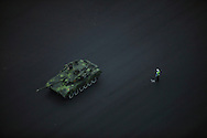 A Chinese military tank heads towards Tiananmen Square where a rehearsal for China's 60th anniversary will be held in Beijing, China, Friday, Sept. 18, 2009.Tanks, armored personnel carrier and rocket launchers rolled along a major Beijing boulevard Sunday in practice for a parade next month to mark the 60th anniversary.