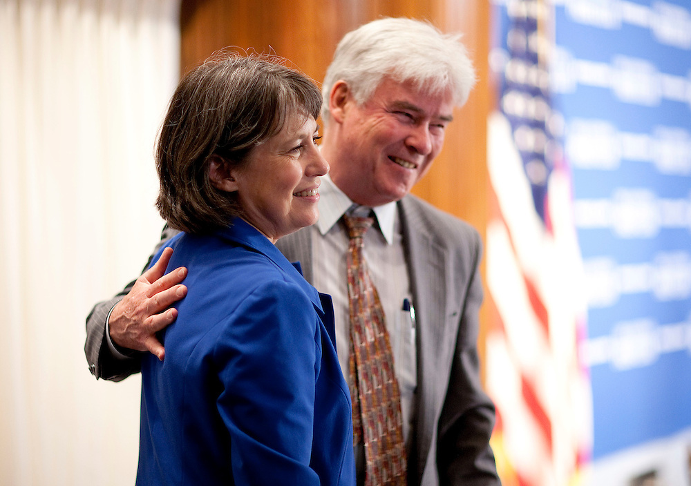 Sheila Bair, chairman of the Federal Deposit Insurance Corp., poses for a picture with her husband Scott P. Cooper at the National Press Club in Washington, D.C., U.S., on Friday, June 24, 2011. Photographer: Joshua Roberts/Bloomberg