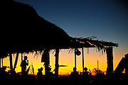SHOT 1/23/10 7:18:22 PM - Relaxing under a beachside palapa restaurant in San Pancho, Mexico. A palapa is an open-sided dwelling with a thatched roof made of dried palm leaves. The Riviera Nayarita is a stretch of coastline between the port of San Blas in the Mexican state of Nayarit southward to where the Río Ameca or Ameca River empties into Banderas Bay. San Francisco, or San Pancho as it is more commonly referred to, is a quaint Mexican village nestled between the verdant Sierra Madre Mountains and jungle and a long stretch of pristine Pacific coast. In close enough proximity (hour drive) to the international airport at Puerto Vallarta, yet full of small town appeal, San Pancho is being proclaimed as one of the next great destinations in the so-called Riviera Nayarita, and as another desirable alternative to the more commercialized vacation typical of resort areas like Puerto Vallarta. With only approximately 1,600 full-time residents, San Francisco still displays the characteristics of a more traditional Mexican town--with men on horseback riding through the streets, or roosters running free in a neighbor's yard for example. Yet even for such a small village, the population is still reasonably diverse. Drawn by the tranquil pace of life, the months of unwavering sunshine, and the tropical coastal atmosphere, San Pancho is also home to a growing number of ex-patriots hailing from the United States, Canada, or even Europe or southernmost Latin America. The result is an eclectic cultural mix that--along with the beautiful natural environs--is creating even more of a draw for visitors and new residents.. (Photo by Marc Piscotty / © 2009)