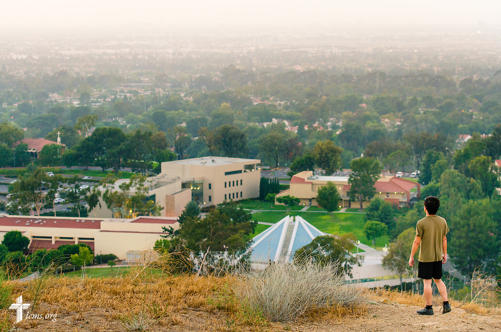 A man looks over the Concordia University Irvine campus during sunset  on Tuesday, July 8, 2014, in Irvine, Calif. LCMS Communications/Erik M. Lunsford
