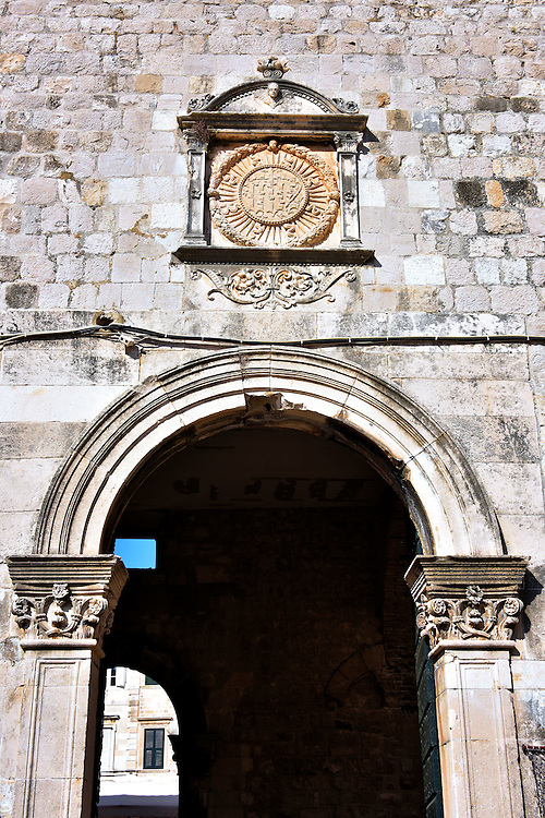 Ponta Gate to Old Port in Dubrovnik, Croatia<br /> During Medieval and Renaissance times, Dubrovnik only had four gates leading into its fortified city walls. Perhaps the least elaborate is the Ponta Gate which means &ldquo;pier&rdquo; in Croatian.  This portal to the Old Port was designed by Juraj Dalmatinac and built during the 15th century by Paskoje Miličević.  If you look to the right as you exit old town you will see the circular St. John Fort.