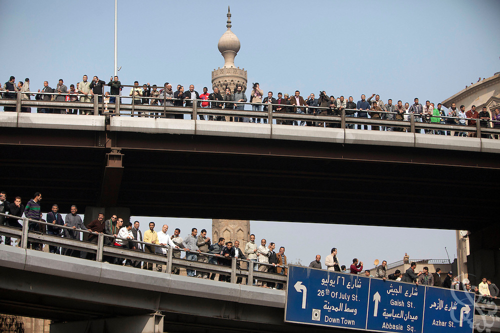 Egyptian protesters line two overpasses above Al-Azhar street during massive and unprecedented demonstrations January 28, 2011 across Cairo, Egypt . The protests, inspired by the recent revolution in Tunisia, have struck a chord with Egypt's population, tired of inflation, high unemployment and alleged corruption within the Mubarak government..Slug: Egypt.Credit: Scott Nelson for the New York Times