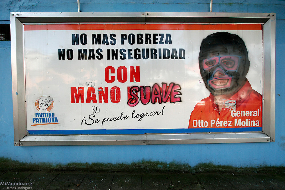 Graffiti defaces political advertisement of former General Otto Perez Molina's Patriota Party. Perez Molina, running in the 2007 presidential elections on a hardline stance against crime, is accused of perpetrating acts of genocide against the civil population during the internal armed conflict in the 1980's. Guatemala City, Guatemala. October 28, 2007.