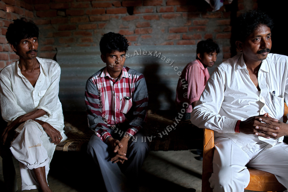 The father of Kanchan Kumari Sharma, 12, Raja Kumar Sharma, 45, (left) a barber, earning around 150 INR a day, (3 USD) is sitting with his brother-in-law, Santosh Kumar, Verma, 42, a small businessman dealing in rice and wheat. With them are Kanchan's eldest brother Avesh Sharma, 24 (second from right) and her older one, Ashok Sharma, 19. (second from left) In 2012, Kanchan went with a friend to bring lunch to her father, around 2 km away from her home. On the way they met Rajesh (rapist) and Ashok, a friend of his. Both girls were picked up on the spot using an excuse. Ashok drove Kanchan's friend home, but Rajesh forced Kanchan to travel with him during six days and for hundreds of kilometres across different states. (Mirzapur / Chennai / Itarsi / Bhusawal) He raped her once behind the station in Itarsi. With great effort and some coincidence, the uncle of Kanchan managed to bring her back home. Although she was scared, she insisted on going to the police to file a case (FIR). She was kept at the police station for 12 days and threatened to prevent her from filing an official case. Ashok and Rajesh are from higher caste and wealthy families. While Rajesh spent 24 days in jail initially in summer 2012, he is now a free man while the trial is still going on. Kanchan's family is now struggling to put together 30.000 Indian Rupees (500 USD) to continue battling for justice in court.