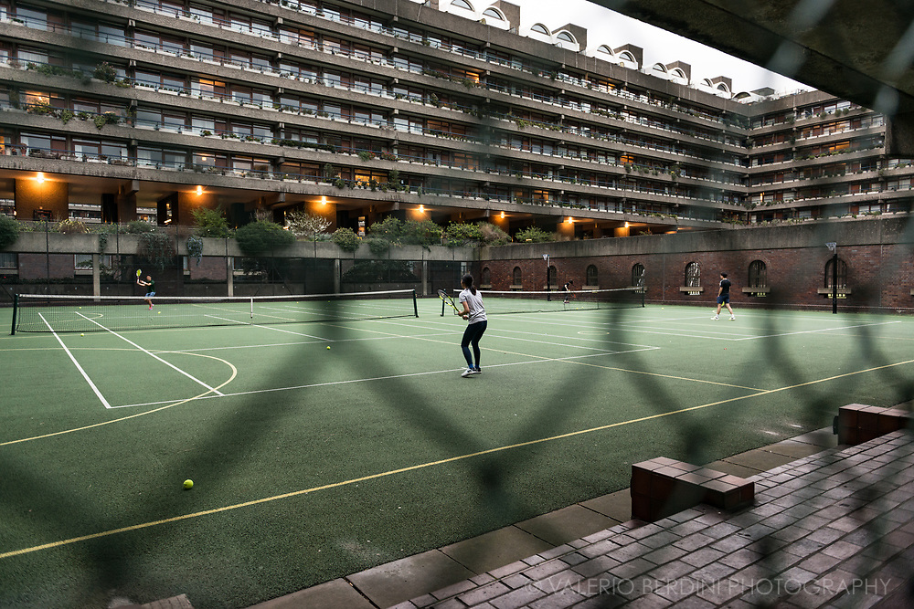 A foreign couple plays in the exclusive tennis court of the Barbican housing complex in London. Access is forbidden for non residents.