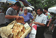 Selling bread in a market in Tashkent, one of the cities on the old Silk Road trading route through Central Asia. Uzbekistan.