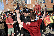 Windsor, Ontario, 2013. A re-enactment of a famous Canaidan labour scene featuring a police officer hitting a worker is one of several novel features at the annual May Day March in Windsor.