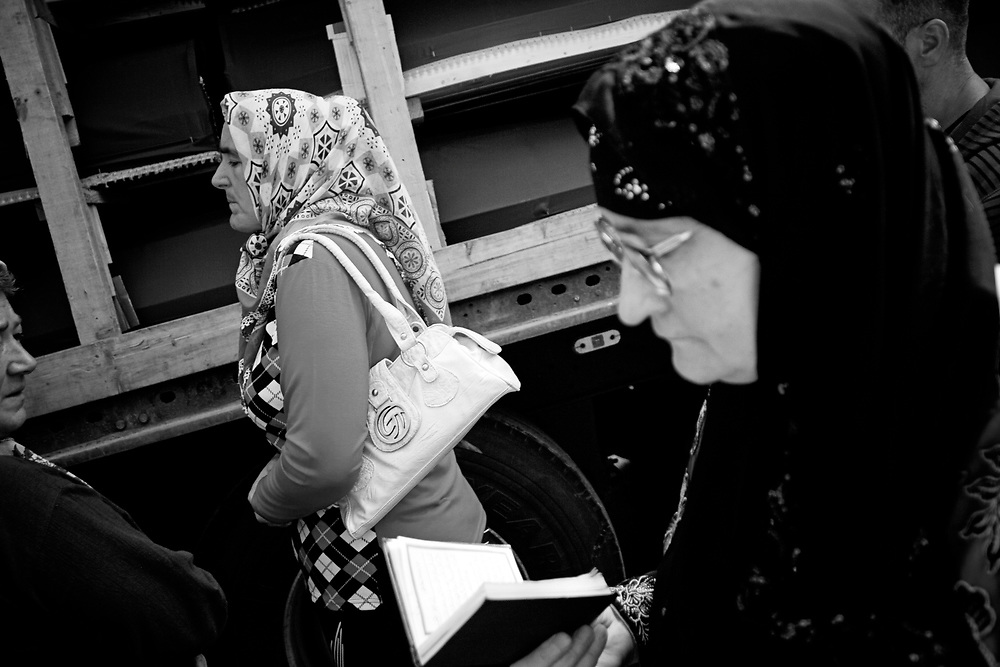 BiH, Visoko, 2009. Mothers of Srebrenica stand in front of buses with coffins of 534 newly identified victims of the 1995 Srebrenica massacre as they leave the town of Visoko for a joint burial July 9, 2009.