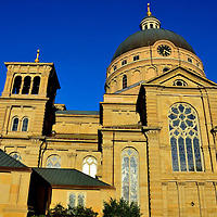 St. Josaphat Basilica at Sunset in Milwaukee, Wisconsin<br /> St. Josaphat Basilica in Milwaukee is one of several Catholic churches in the Great Lakes and middle Atlantic regions designed in the &ldquo;Polish Cathedral Architectural Style.&rdquo; They tend to be large, ornate and served Polish immigrants. This one, built in 1901, was patterned after Rome&rsquo;s St. Peter&rsquo;s Basilica. The church was built using stones from the demolished Chicago Federal Building. It is crowned by a massive cooper dome. Pope Pius XI designated it as a minor basilica in 1929. St. Josaphat is managed by the Franciscan Friars.