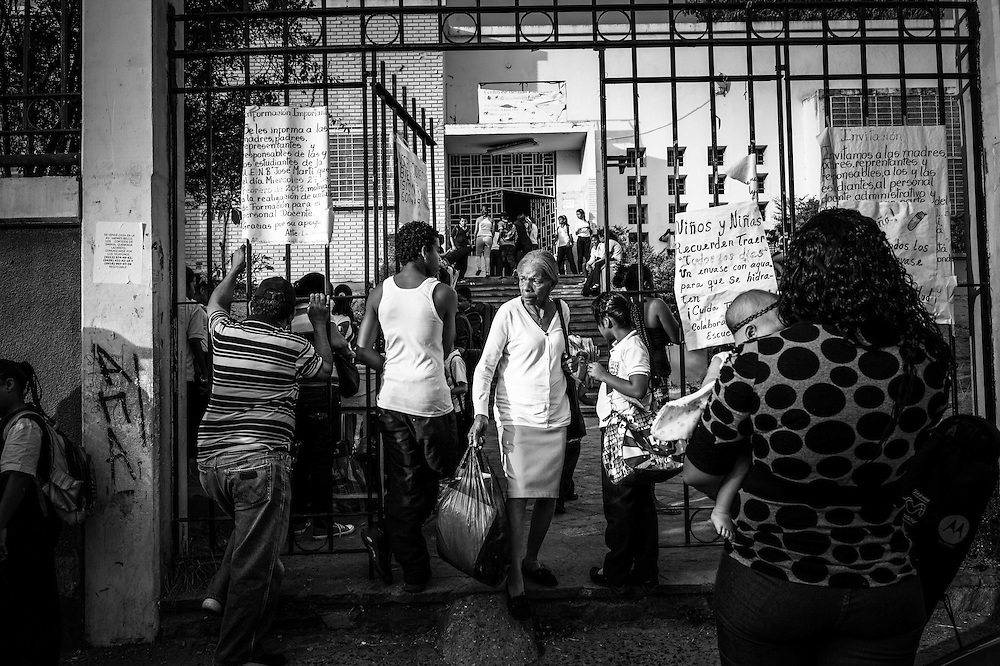 Children come and go at the entrance to Sarria nucleo, of the El Sistema music program in a dangerous slum in Caracas, Venezuela
