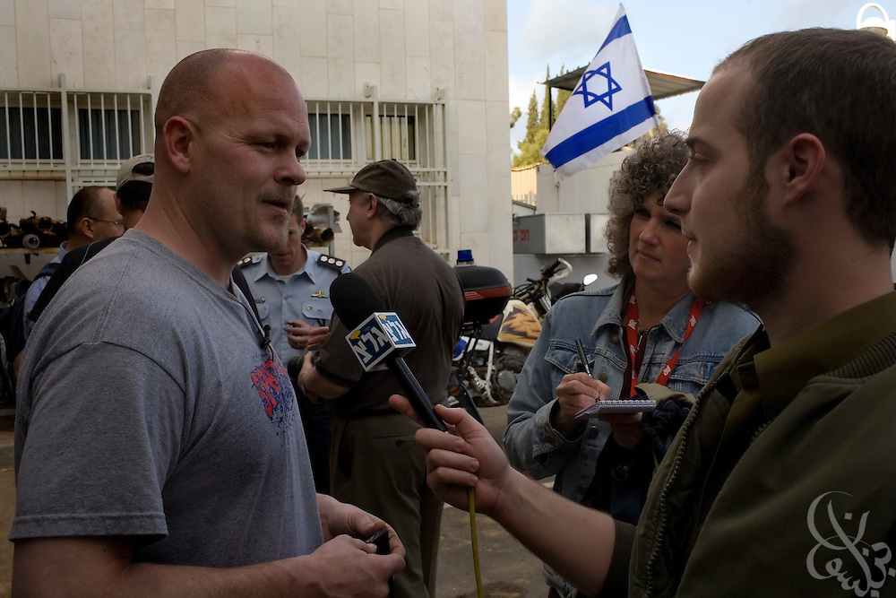"Samuel J. Wurzelbacher, better known as ""Joe the Plumber"", is interviewed by an Israeli soldier January 11, 2009 in Sderot, Israel. Wurzelbacher, who rose to fame during the 2008 election after questioning then presidential candidate Barack Obama about his tax plan, is in the region for about 10 days  to report as a war correspondent for the conservative web site Pajamas TV (www.pjtv.com.)"