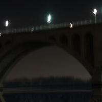 The Key Bridge is reflected in the Potomac River in Washington, DC.