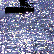 Paul Lowe of Bowling Green, Ky., fishes on the lake at Basil Griffin Park in Bowling Green, Saturday, Nov. 27, 1999. Unseasonably warm temperatures in southcentral Kentucky sent many outdoors. (AP Photo/Daily News, Joe Imel)